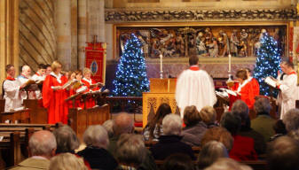 Photograph of Waltham Abbey Choir singing at a christmas service.